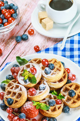 waffles with berries on the table