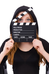 Cute witch with movie board isolated on white