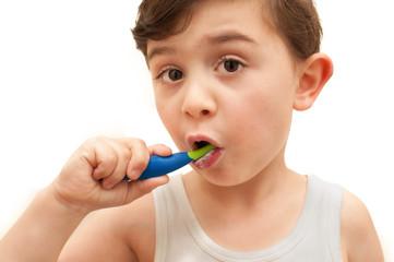 Young boy brushing teeth isolated