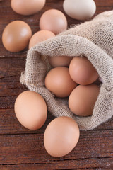 eggs in a linen sack on the wooden table