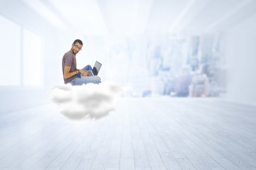 Composite image of man wearing glasses sitting on cloud using la