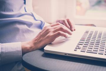 close up hands multitasking man using  laptop