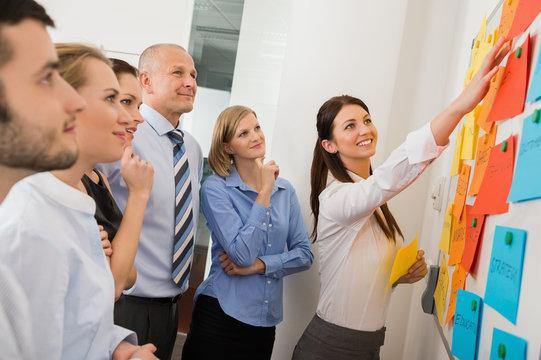 Businesswoman Pointing Labels On Whiteboard