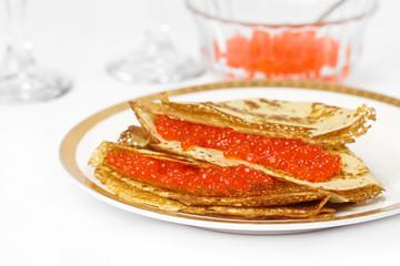 Pancakes with caviar.