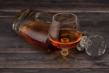 Cognac on  wooden background