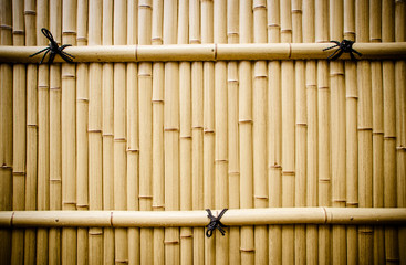 plastic bamboo fence in japan on rainy day