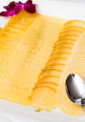 Various types of cheese sliced on a plate