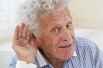 senior man, hard of hearing,  asking to speak up