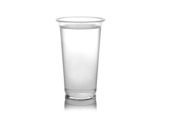 Plastic glass of water isolated on a white background.