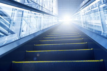 escalator leading to light. ( metaphor concept)