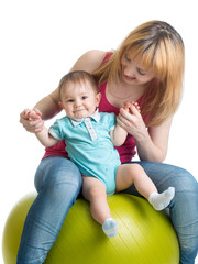 mom and baby having fun with  gymnastic ball