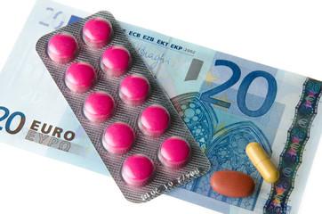 Pills on a banknote