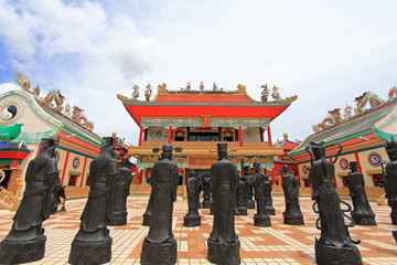 Statues of Shaolin monks showing martial arts at Viharn Sien