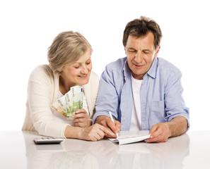 Senior couple with money