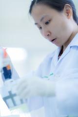 Scientist using a pipette