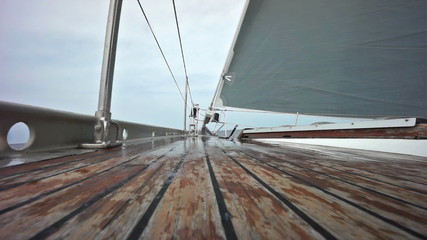 Fototapete - Sailing ship with wave splashing on the deck in slow motion