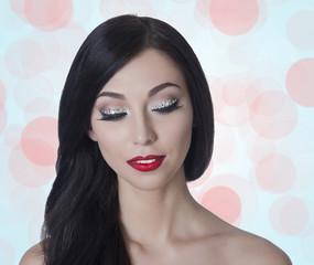 brunette with long eyelashes