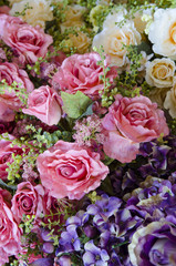 wedding bouquet with rose bush, Ranunculus asiaticus as a background