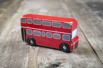 Old wooden English red bus