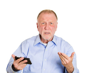 Old man receiving bad news on cellphone device