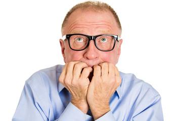 Anxiety, headshot stressed senior man biting fingernails scared