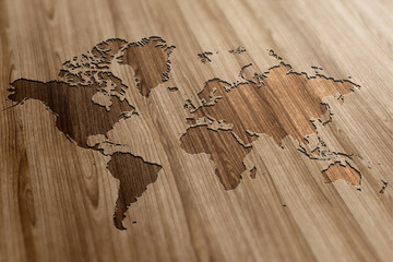 Wall Mural - World Map on Wooden Background