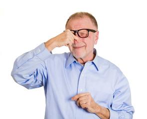 Something stinks. Portrait older man pinching his nose