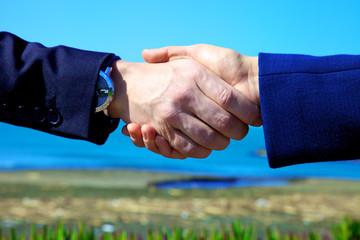 Hand shake between business people