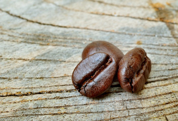 roasted coffee beans on wood  background. macro front view