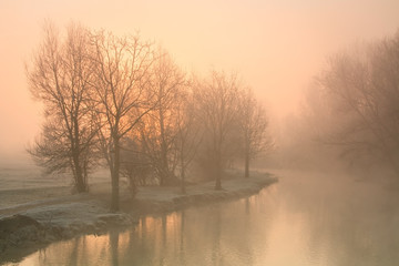 Foggy river Thames near Oxford on a winter morning.