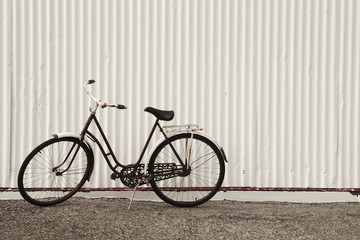 Iceland. Seydisfjordur. Antique bike and white facade.