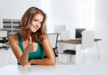 Smiling girl in casual clothes in the office