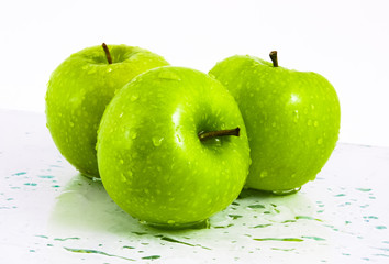 Green apples with waterdrops on table