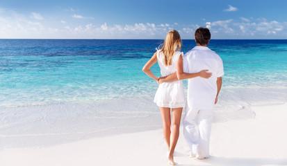 Loving couple enjoying seascape