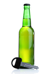 Composition with car key and bottle of beer, isolated on white