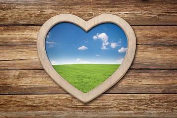 Wall Mural - Herz im Holz mit Landschaft