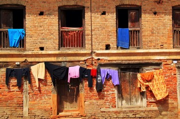 Hanging clothes outdoor the slum building