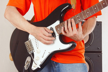 Hands of rock guitarist playing the guitar
