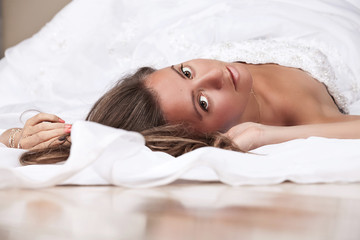Bride lying on the floor