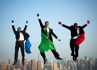 Multi-ethnic Superhero Businessmen Jumping