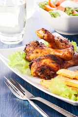 Chicken drumsticks with chips