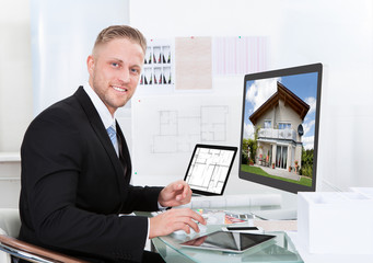 Businessman checking a property portfolio online