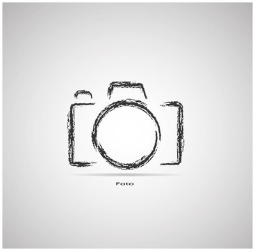 camera on a gray background is drawn with chalk