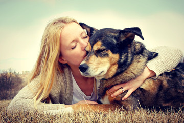 Woman Tenderly Hugging and Kissing Pet Dog