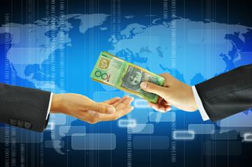 Businessman hands giving money - Australian dollars