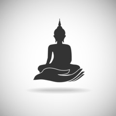 Buddha image on hand silhouette
