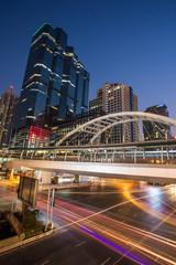 public skywalk in bangkok at night in business zone