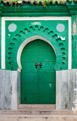 Fototapete - Green gate of ancient mosque in Medina. Tangier, Morocco