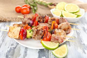 Pork kebab on wooden table close up