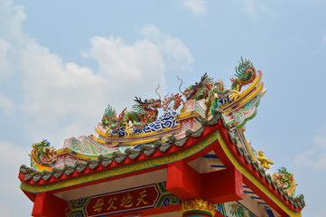 Chinese style roof of door facade or arched gate of shrine